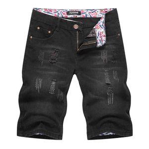 El nuevo estilo de verano pantalones cortos de mezclilla para hombre Negro de cinco puntos Pantalones holgados Europea y Americana rasgada