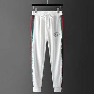2020 nuovi sport dei pantaloni piedi Larghezza sciolti degli uomini del ricamo casuali pantaloni di seta del ghiaccio di estate di grandi dimensioni di tendenza allentata maschile 9 punti pantaloni