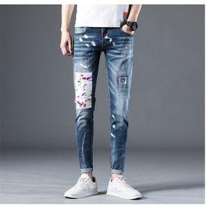 Primavera para hombre Hole Patch pantalones vaqueros lavados de tinta que salpica masculino lápiz rasgados Distrressed Boys de la manera Pantalones