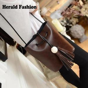 Designer-Vintage Tassel seau Sac pour les femmes Fringe White Ball Femme Messenger Bag Sac à bandoulière en cuir PU chaîne Casual femmes Sac à main