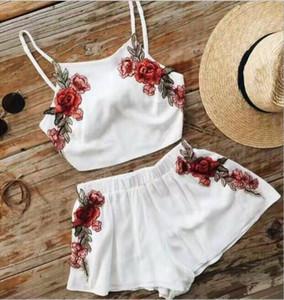 2PCS ملابس النساء أزياء الصيف مثير مجموعات التطريز الصلبة قصيرة العزاء حزام المحاصيل الأعلى والسروال مجموعات بيضاء