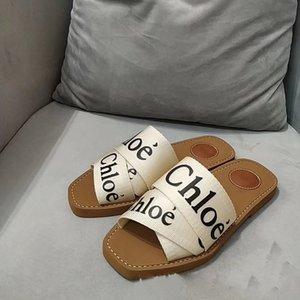 2020 cuero de nuevo de las mujeres de Woody mulas Fflat Zapatilla Deisgner Señora letras Tela al aire libre Sole Slide Sandal