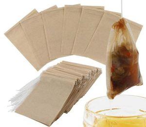 100pcs / Lot Thé filtre sacs en papier naturel écrus Sac Thé à usage unique Boule à thé sac vide avec cordon de serrage pour herbes Café 6 * 8cm