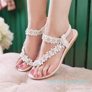 Bohemia women's sandals pinch summer flowers flat summer shoes Korean style beach sandals two colors s09