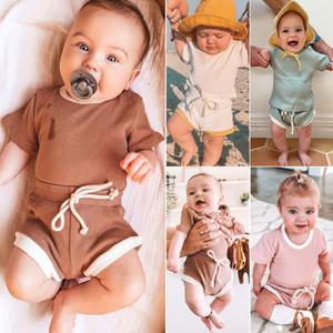 2020 Nuevo color sólido Pit algodón cuello redondo bebé niños ropa de niño niña camiseta de manga corta Camisas y pantalones 2pcs / set de 9 colores
