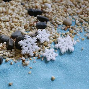 100pcs / lot mini resina del copo de nieve de Navidad Figurita Hada del jardín DIY Crafts Moss Micro ornamento paisaje Miniaturas