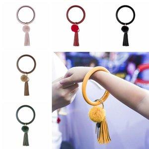 Frauen Art und Weise PU-Leder Schlüsselbund runde Form Armband-Schlüsselring-Kreis nette gedruckte Troddel Pom Pom Keychain LJJ-TA1861
