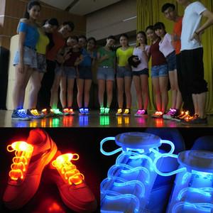 Suministros de zapatos LED luz del resplandor del cordón que destellaba luminosos coloreados Deporte fibra óptica partido de la luz KTV bar cordones de los zapatos de baile de la danza de la novedad de Navidad