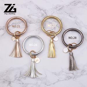ZG PU cuir femmes O KeyChain Custome Cercle mignon Imprimé Fleur Tassel Bracelet en gros 28 femmes Couleurs Keychain