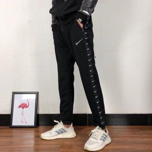 Tick Marchio sudore pantaloni da uomo di marca del progettista pantaloni Primavera Sport Donne Pantaloni sportivi Jogger lettera stampata unisex Pantaloni Streetwear 20042002L
