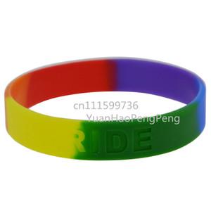 50pcs / lot color del arco iris del orgullo gay de Debossed logotipo orgullo Pulsera pulsera de silicona