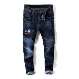 European standing men's jeans, men's jeans, a pair of skinny jeans and black embroidered skulls