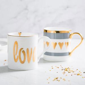 12 estilos Estilo nórdico Descripción breve Taza de cerámica de oro Taza de agua de oficina Desayuno casero Tazas de café Taza de cerámica de la pareja de leche