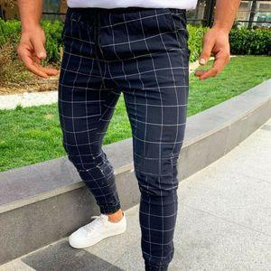 Die Sporthosen der heißen Männer langer karierter Trainingsanzug-dünne elastische Sitz-Trainings-Rüttler-beiläufige Jogginghose-männliche beiläufige Hose M-3XL
