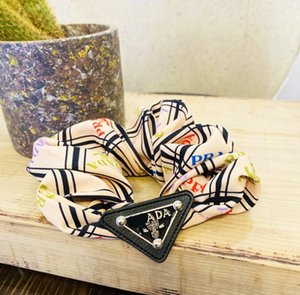 P clip European and American catwalk metal triangle standard silk satin hair ring large intestine ring temperament wild ball designer hair b