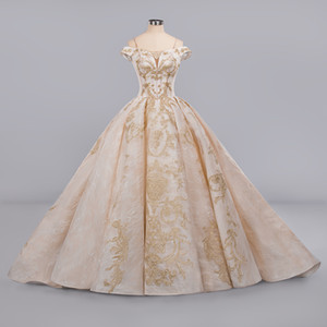 Cuadros reales Vestido de fiesta con apliques de encaje rosa con lentejuelas vintage Vestidos de novia Vestidos de espagueti de lujo Una línea más el vestido de novia Arabia Saudita Dubai