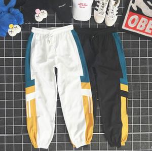Desenhador de moda calças dos homens New Pants de luxo com padrão Painéis solto cordão Sport calças casuais nove pontos Sweatpants para Homem Mulher