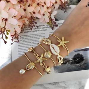 ALYXUY 5Pcs / Set Ozean-Art-Goldketten-Shell-Perlen-Armband-Set für Frauen Bohemian Seestern Kette Charm Armband Schmuck Geschenk