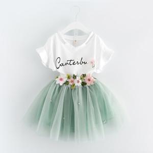 Estate coreana 2019 vestiti per neonate Abiti Abiti T-shirt bianca lettera Gonna tutu fiore 2 pezzi set abbigliamento floreale per bambini Abiti A488