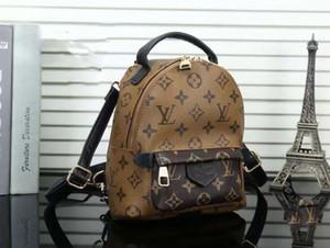 erkekler kadınlara tasarımcı sırt çantaları, mini kapasite moda seyahat çantaları okul çantalarını lüks klasik tarzı hakiki deri üst KALİTE v2525