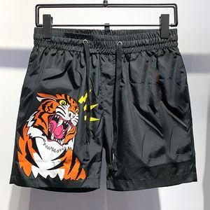 Diseñador del verano pantalones cortos para hombre de la moda impresos con cordón cortocircuitos Relajado hombre de la ropa de lujo Homme Camuflaje Imprimir Hip Hop pantalón