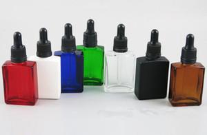 OEM حاوية جرة زجاجية 5ML 6ML للشمع الجاف عشب ه السائل غطاء غطاء أحمر أخضر سيليكون طباعة شعارك