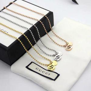 Chaude vente concepteur creux lettre G chaîne de perles rondes collier mode marée sauvage titane acier collier