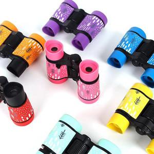 Lo nuevo plástico de los niños 4x30 prismáticos de goma bolsillo de la manija del color telescopio antideslizante impresión al aire libre del regalo del juguete del juego
