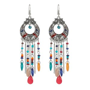 Original exaggerated round hollow European and American fashion earrings female bohemian holiday style long tassel water drop earrings