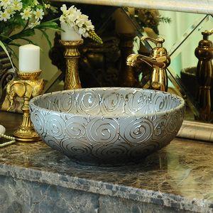 Jingdezhen fábrica diretamente Arte pintada à mão lavagem cerâmica bacia banheiro pias rosa cor de prata