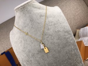 Nanogram necklace with round bead chain paired with a pair of rapper miniature name tags engraved with the Initials logo Circle gold silver
