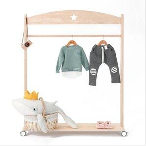 Children's clothing store shelf display rack floor roller star clothes rack Nordic style log series clothing store household storage rack