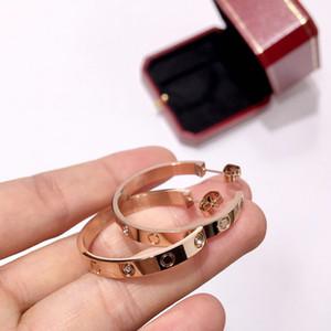 Orecchini da uomo e da donna con gioielli in vendita calda in acciaio inossidabile Moda orecchini a vite in acciaio al titanio a forma di C in cristallo