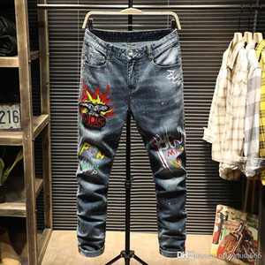 Luxury mens jeans fashion brand explosion locomotive ripped jeans designer stretch letters pattern slim feet pants