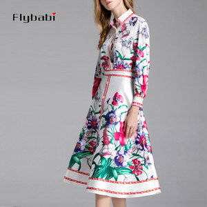 Europe and the United States 2019 new fashion elegant ladies suit flower print lapel long-sleeved shirt + A-type skirt 2 sets