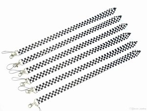100pcs all'ingrosso in bianco e nero Cell Phone Straps Charms