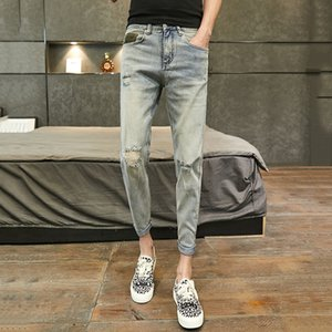 Net red hole nine points jeans male vibrato tide brand summer thin section slim feet summer pants Korean version of the trend