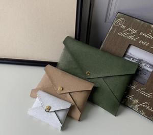 3 nouvelles pièces combinaison Designer bourse Top femmes bourse design de qualité portefeuille sac d'embrayage Sacs avec boîte Kirigami 67600 Pochette
