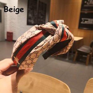 Cinta de cabeza de la nueva marca de la venda del diseño de letras Hairbands acoplamiento de la gasa rayada Bowknot headwear hecho a mano arco de la tela Mujeres Accesorio para el pelo