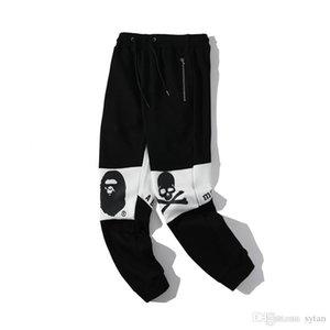 Pantalones calientes de la venta mujeres de los hombres Negro Blanco Empalme Letter Print Pantalones hombres sueltos de algodón del amante de los pantalones largos del basculador Correr pantalón