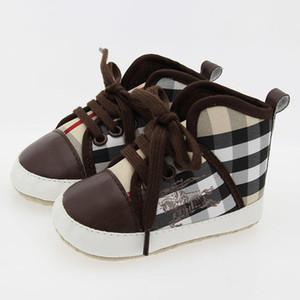 Nuovi plaid bambini ragazzo ragazza scarpe suola morbida tela solido designer PU calzature per neonati bambino presepe mocassini 2 colori