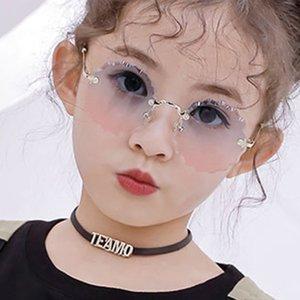 Retro occhiali da sole per bambini fiori rotonda ondulate senza telaio Occhiali da sole per la ragazza / ragazzo del progettista di marca Eyewear UV400