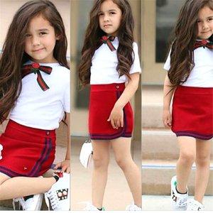 Uniforme del niño de la niña de juego de ropa Kid flor del arco Littler verano de las muchachas 2 pedazos del lazo cortocircuito de la camiseta mini falda Trajes T200805