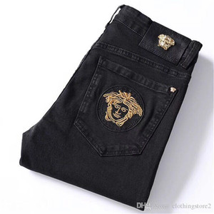 Modetrend Tier bestickte Jeans Herren-Herbst / Winter neue schwarze Schlankheits Form kleine Füße lange Hosen