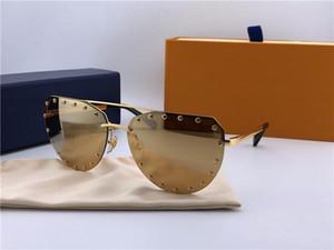 El nuevo diseñador de moda gafas de sol de marco irregular 0984 sin marco con remaches populares vanguardista estilo de gafas de protección UV400 de primera calidad