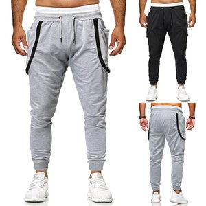 Brand designer Ouma 2019 foreign trade new men's fashion solid color stitching zipper pants casual trousers bundle a generation of fat