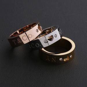 anillo de hombre del anillo de boda anillo de amor diseño hueco de acero de titanio del corazón del melocotón