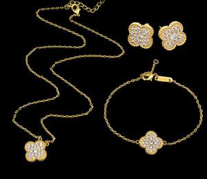 Joyería pendientes del collar de la pulsera de Queen Lotus de alta calidad de la manera 18K plateó la serie de las flores al por mayor para las mujeres Conjunto