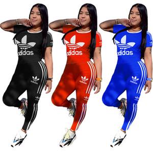 Kadınlar Tasarımcı 2 Adet Takımı Kısa Kollu T-shirtler + Tozluklar Jogger Suit Çizgili Tee 2757 + Capris Eşofman S-2XL Spor Yaz Tops