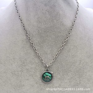 Sterling silver S925 Gu Jiashuang G letter stereo king snake peacock green resin men's and women's necklace sweater chain